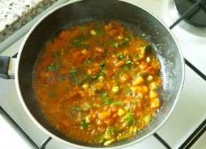 Shakshoukeh cooking onion with tomato
