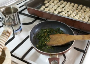 Shishbarak: frying garlic and coriander